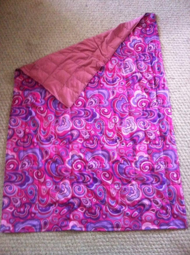 A wonderful girls weighted blanket made by Kathy Anderson.